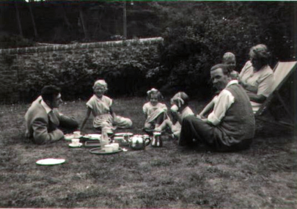 Auntie Belle and family, front garden at Whitelaws (1955)
